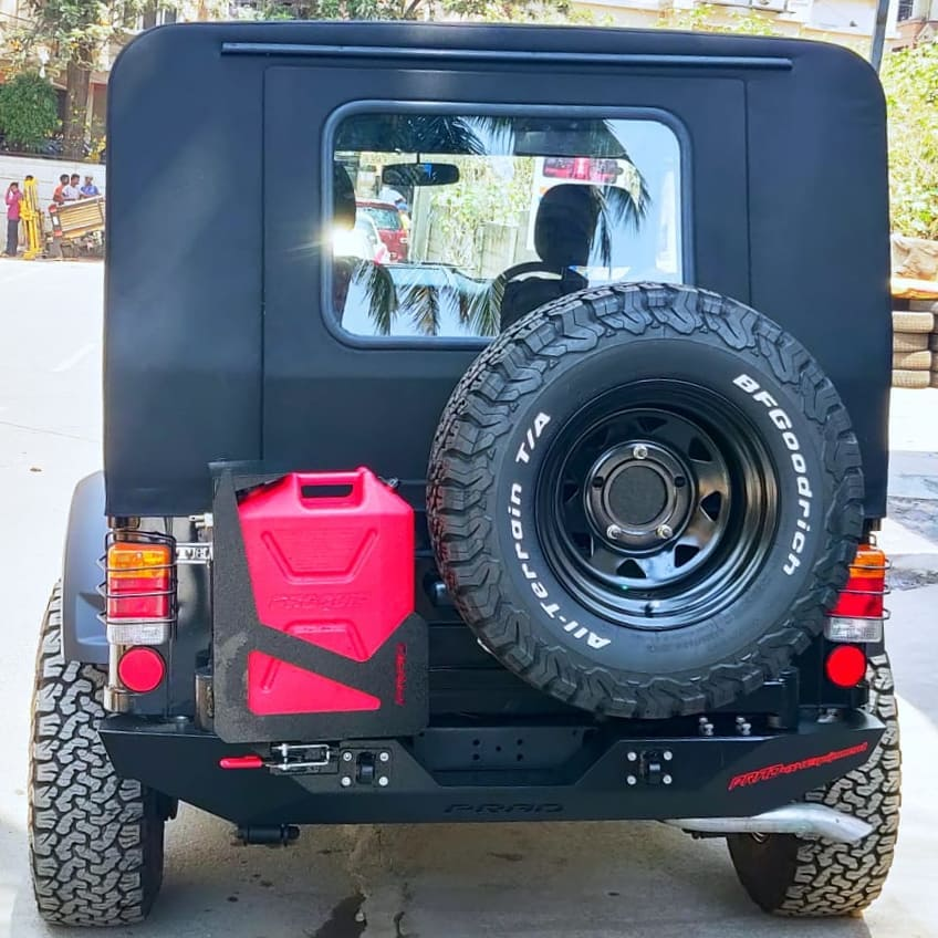 Metal Hardtop and Tandem Tyre Carrier with Dual spindle Jerry can holder on Mahindra Thar.